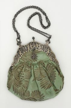 Purse: ca. 19th century, American, brocaded silk, silver, silk satin, metallic thread.