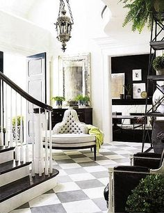 Black and white stairs=check, checkered floor=check, vintage round high-back settee=check, black door=check!