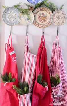 A FARMHOUSE CHRISTMAS | Don't these red and white aprons remind you of candy canes? | This time of year I'm wearing the colors of the holiday around the kitchen! |