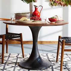 """$899.00, 44"""" from West Elm...Contemporary classic. Pedestal dining tables free up leg room, making them a great small-space solution. To give ours an industrial twist, we paired its warm mango wood top with a hand-cast metal base."""