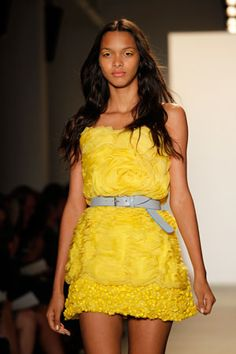 yellow eyeliner paired with beachy waves at Peter Som Spring 2011