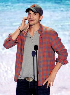 """Actor Ashton """"Chris"""" Kutcher speaks onstage at the 2013 Teen Choice Awards at the Gibson Amphitheatre in Universal City, California on Aug. ..."""