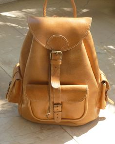 this natural leather backpack would go with me everywhere.