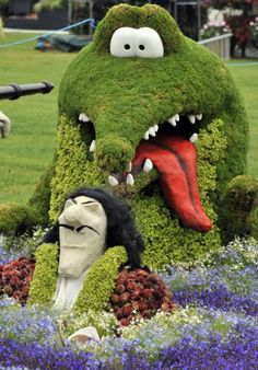 A topiary Captain Hook and crocodile at the RHS Flower Show At Tatton Park, Knutsford, July 2009.