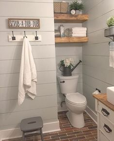 Hooks for towels Farmhouse Bathroom / Shiplap / Brick Floor / Bathroom Inspiration #CountryDecor #bathroomremodeling
