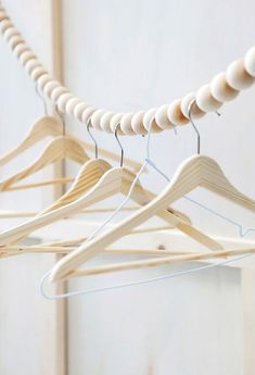 Fuers Heim Snake clothes rail - This hanging wooden bead garland was designed as clothes line or wardrobe rail. Handmade in Germany from 40 beech wood balls. Clothes Rail, Hanging Clothes, Clothes Line, Clothes Stand, Clothes Hangers, Diy Clothes, Wardrobe Solutions, Do It Yourself Inspiration, Bois Diy