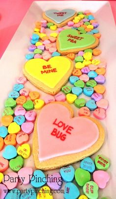 Conversation hearts sugar cookies- I ❤ this presentation- whether it is on a serving platter far a Valentine Party or in a heart box for a Valentine gift, the heart cookies atop the conversation hearts is so festive!  :)