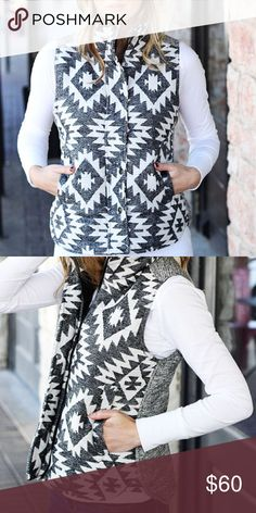 Black and white geometric vest Black and white geometric vest.  Lining 100% polyester, self 100% cotton. Price firm. NWOT, Runs a little big.  Could wear sweaters under. Jackets & Coats Vests
