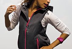 Subtle shimmer and hot-pink detailing make this water-resistant vest a stylish layering piece.