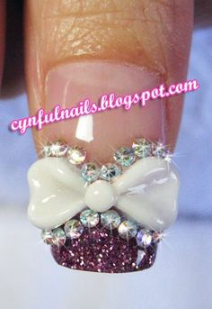 Rhinestones & 3D bow nail art...holy monkeys! It's gorgeous!!!!!