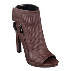 """A gazillion perforations steal the show as they flaunt tons edgy attitude. (Did we exaggerate too much?) The point is, whenever these peep toe booties walk into a room, they get noticed -- a lot. Comfortable slingback strap with Velcro(R) closure. Side zip for easy on/off. A padded footbed provides all-day, into-the-evening comfort. Leather upper. Man-made lining and sole. Imported. 1/2"""" platform. Covered 4 1/2"""" high heels."""