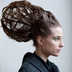 Maurizio Galante: A second style on the Maurizio Galante runway gave more of a 3D effect. The orbs used to sculpt the hair-raising style were removed before the show.