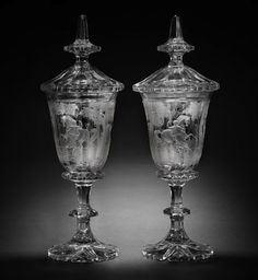 Pair of engraved goblets and covers 33 inches high. Bohemian, 1st half of 19th century and very much in the Beidermeier taste. Depict a deer hunt.