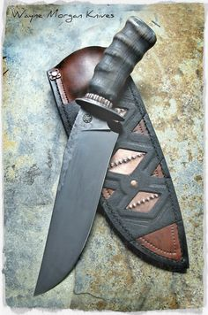 Wayne Morgan Knives.  I really like the handle material. FOR A TRAITOR IT HAS ITS PURPOSE... OTAY GUBERNORIS