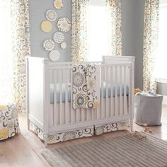 Adorable idea for a Nursery, colored plates on the wall.