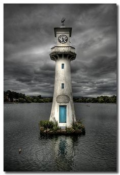 This is the clock tower at Roath Park lake, Cardiff. It's called the Scott Memorial, and was built in Lighthouse Pictures, Lighthouse Art, Beacon Of Light, Water Tower, Am Meer, Le Moulin, Cool Stuff, Belle Photo, Color Splash
