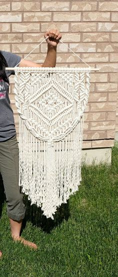 Large Macrame Wall Hanging! A macrame wall hanging that takes the spotlight in the room which it is set. Very elegant in any room, and matches the decor while bringing a boost to the feel of the room that it is displayed.