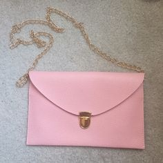 Pink envelope purse Really cute never before used pastel pink envelope style purse with button closure. $10 price FIRM. Included free with any purchase of $50 or more Bags