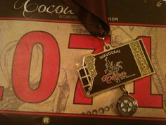 Medal for the first Cocoa Women's Half Marathon.