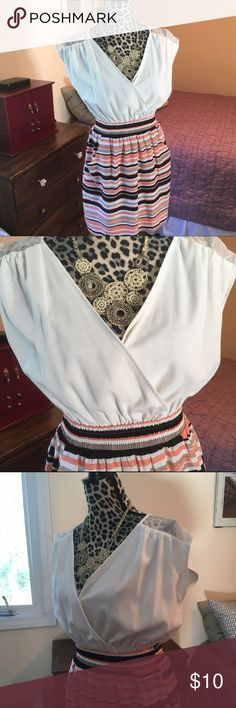 Francescas dress w pockets FINAL SALE!!! Francesca's Faux Blouse and Shirt Dress. Pockets. Orange, tan, black, and white skirt with loose white blouse-like top. Cinched at the waist. Can unbutton top for more cleavage. Short and sweet. Francesca's Collections Dresses Midi