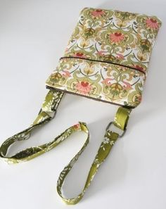 e-reader Hipster bag!  1/2 yard of 3 coordinating/contrasting fabrics, batting or fleece, thread, 2 zippers and rectangle purse rings!