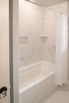 Bath Surround and Flooring: Tile, Mayfair 12x24, Statuario Veneto; Grout: Frost