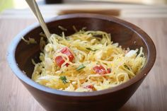 spaghetti squash with olive oil, feta, tomatoes, basil, onions, salt and pepper.