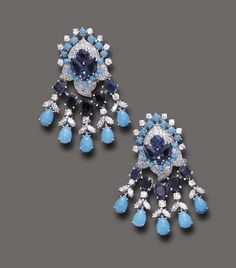 FROM THE ESTATE OF DORIS DUKE: A PAIR OF SAPPHIRE, TURQUOISE AND DIAMOND EAR PENDANTS, BY DAVID WEBB Of Indian style, each pavé-set diamond foliate plaque, enhanced by vari-cut sapphires and turquoise, suspending an oval and rectangular-cut sapphire swag, to the circular and marquise-cut diamond foliate motifs and pear-shaped cabochon turquoise terminals, mounted in platinum, circa 1969.