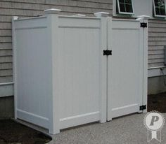 Vinyl fencing used as a pool shower enclosure.