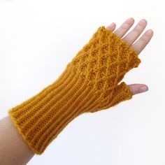 Make these pretty fingerless gloves with Lion Brand Wool-Ease! Get the free knit pattern on Ravelry: Trellis Fingerless Gloves by Elizabeth Seidle.