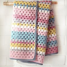 Use the crochet granny stitch to work up this darling blanket for a baby girl