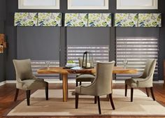A bold print valance with a pop of color gives this dining room added design. #BudgetBlinds