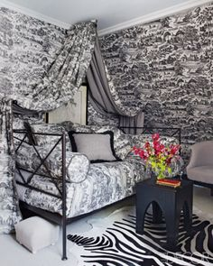 its a bit much but I just can't not pin it!  In a London guest room, the walls are covered in a toile de Jouy by Brunschwig & Fils that is also used for the canopy, pillows, and bedding; the artwork is by Dick Bixby.