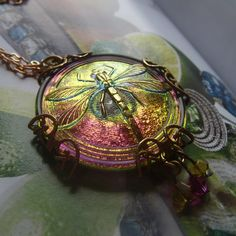 Beautiful lime and fuchsia dragonfly pendant. Czech glass wrapped in a ornate brass filigree, embellished with Swarovski crystal in fuchsia and lime. Measures approximately Hangs from a dainty peanut chain. Dragonfly Necklace, Dragonfly Pendant, Pendant Necklace, Baubles And Beads, Texture Design, Swarovski Crystals, Jewelery, Jewelry Making, Bangles