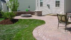 curved patio with seating wall around firepit