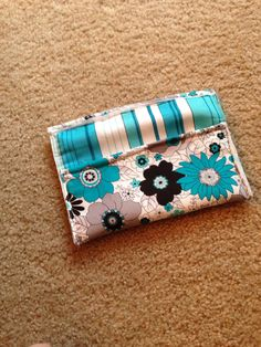 Matching floral and stripe clutch