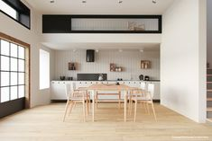 This spacious and uncomplicated dining room uses light tones throughout. The kitchen area is quite interesting: vertical white paneling frames the view nicely, with box-shaped shelves storing functional and attractive accessories. ➤ Discover the season's newest designs and inspirations. Visit us at  www.moderndiningtables.net #diningtables #homedecorideas #diningroomideas @ModDiningTables