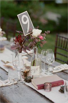simple flower wedding centerpieces in a wine bottle and milk glass vase | photo: www.brandonchesbro.com