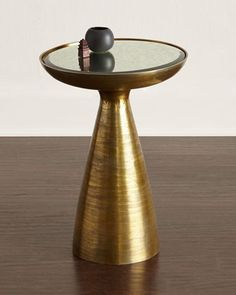 """Handcrafted side table. Made of cast, molded aluminum. Inset mirrored top. Brushed brass finish. 16""""Dia. x 22""""T. Imported. Boxed weight, approximately 27 lbs."""