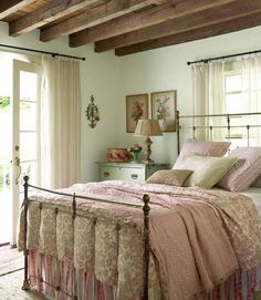 Lovely romantic bedroom with pink floral bedding