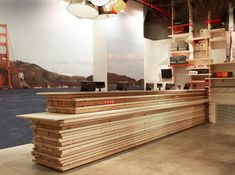 Stacked lumber sales counter at Levi's new flagship store in Paris