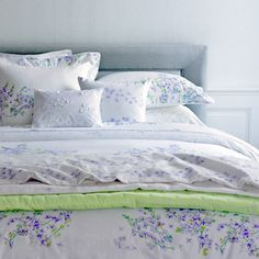 Don't be blue! Etre Bleu by Yves Delorme is a floral print design that combines an overlay of lilac flowers in striped white and lilac onto stratocumulus clouds, which creates fog when met with the land. White, percale sheeting is the backdrop to soft hues of lilacs and greens. Shown with Triomphe New Quilting Style coverlet. You are sure to add life to any bedroom with Etre Bleu!
