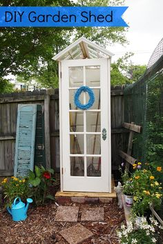 Garden Shed made from old windows and doors from A Cultivated Nest