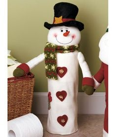 This soft fabric snowman stores rolls of toilet paper under wraps and serves as part of your holiday decor. Felt Christmas, Christmas Snowman, Christmas Time, Christmas Stockings, Christmas Ornaments, Snowman Crafts, Holiday Crafts, Holiday Decor, Theme Noel