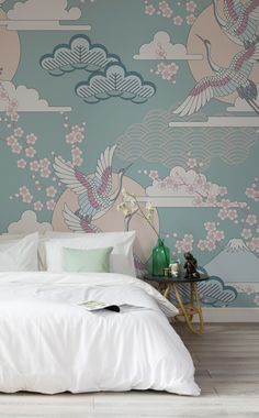 Wake up in a tranquil space every day with this wonderful wallpaper design. Illustrated cranes fly amongst branches of cherry blossoms, floating clouds and mountain tops. The calming pastel colours look beautiful in bedroom spaces.