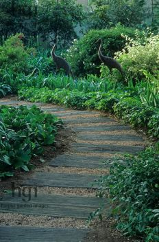 Wooden sleeper slab path with gravel  Jerry Harpur,