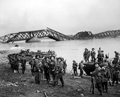 Men of the British 1st Cheshire Regiment crossing the Rhine River with Buffalo tracked landing vehicles at Wesel, Germany, 24 Mar 1945. (Imperial War Museum)