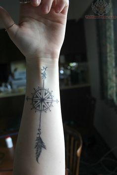 Arrow Compass Tattoo On Wrist but white and tiny on back of neck