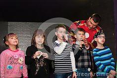 Children sing at a karaoke club.Ukraine,Kiev.Kidlandia 19 February 2017