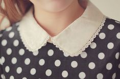 Cute combination with the white peter pan collar with the black and white polka dots.